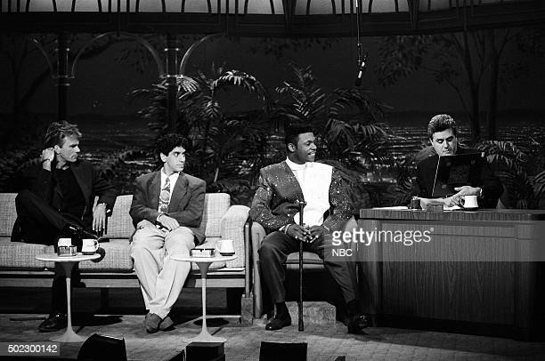 Actor Richard Dean Anderson comedian Jeff Cesario and musical guest Keith Sweat during an interview with guest host Jay Leno on April 19 1991
