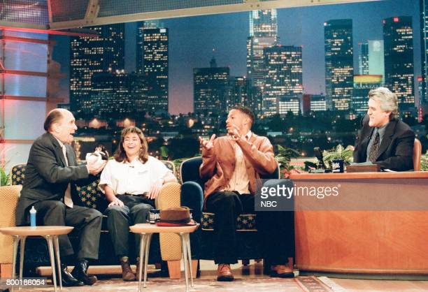Actor Robert Duvall animal ambassador Julie Scardina and actor Marlon Wayans during an interview with host Jay Leno on February 11 1998