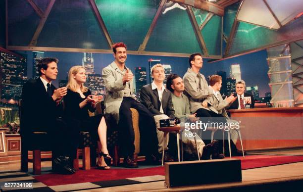 Actors Scott Wolf and Reese Witherspoon and musical group N'Sync during an interview with host Jay Leno on April 12 1999