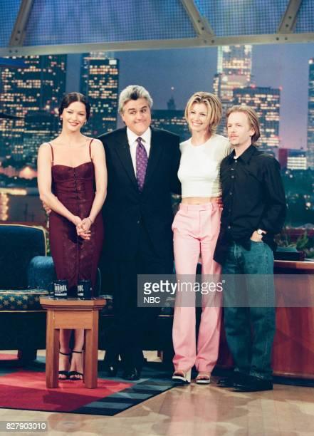 Actress Catherine Zeta Jones host Jay Leno musician Faith Hill and actor David Spade pose for a photo on April 29 1999