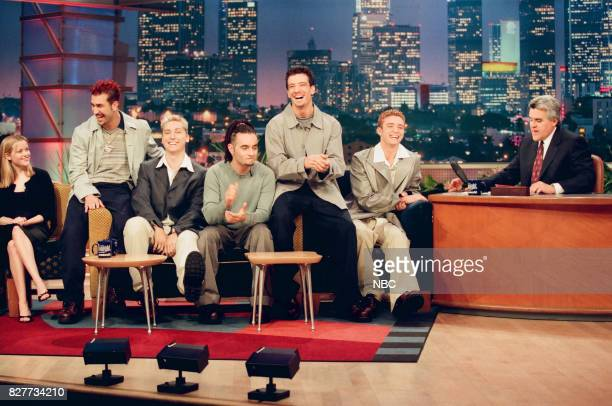 Actress Reese Witherspoon and musical group N'Sync during an interview with host Jay Leno on April 12 1999