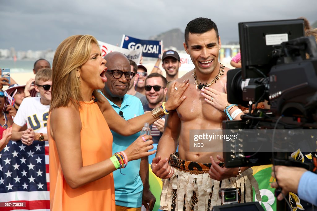 Anchor Hoda Kotb oils Tongan flag bearer Pita Taufatofua on NBC's 'TODAY' show at the Rio Olympics on Monday, August 8, 2016 --