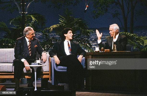 Announcer Ed McMahon and comedian Jeff Cesario during an interview with host Johnny Carson on January 4 1991
