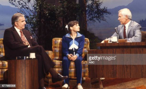 Announcer Ed McMahon Gymnast Tracee Talavera during an interview with host Johnny Carson on August 10 1979