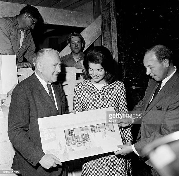 Architect Marcel Breuer Jacqueline Kennedy and NBC President Robert at the construction site of the Whitney Museum in New York City on October 21 1965