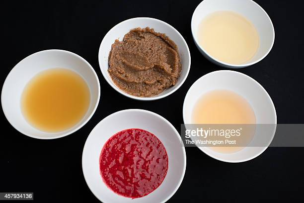 Pictured are all the ingredients for Raspberry Vinaigrette From top right pear juice homemade date puree apple juice apple cider vinegar and...