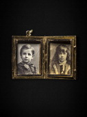 Pictured are photographs of Isidor Straus's two children inside a gold locket recovered with Mr Straus's body from the Titanic and returned to Mr...