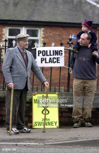 Pictured are SNP supporters Alex Goodall son Lewis aged 2 months and Bob Bisset Voters were braving the elements to make their way to the polls in...