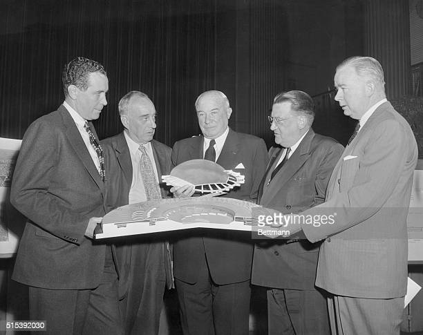 Pictured are Thomas Goodfellow President of the Long Island Railroad Robert Moses Commissioner Triborough Bridge and Tunnel Authority Bernard Gimbel...