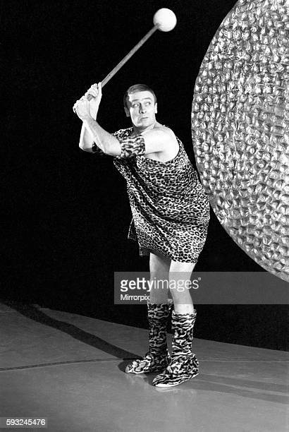 Pictured at Teddington TV Studios Teddington Lock actor Edward Woodward is dressed in a parady of the Rank Organisations iconic opening gong sequence