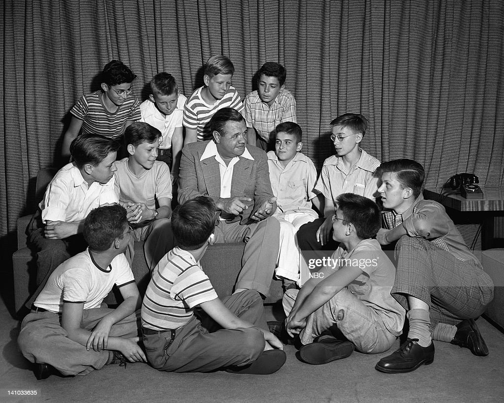 Baseball player Babe Ruth talking with young fans in 1944--
