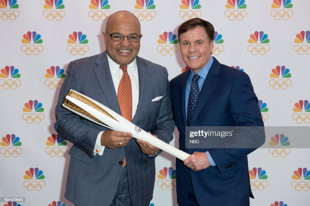 Bob Costas (right), who has served as NBC?s primetime host for a U.S. record 11 Olympics, passes the Olympic torch to Mike Tirico (left), who will make his debut as NBC?s primetime Olympic host at The Winter Olympics in PyeongChang, South Korea, in 2018 --