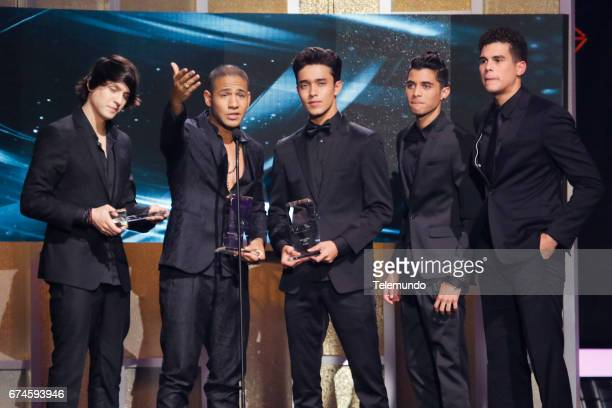 CNCO accepts the 'Latin Pop Album Artista del Ano Duo o Grupo' award on stage at the Watsco Center in the University of Miami Coral Gables Florida on...