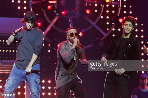 CNCO and Yandel perform during rehearsals at the Watsco Center in the University of Miami Coral Gables Florida on April 26 2017