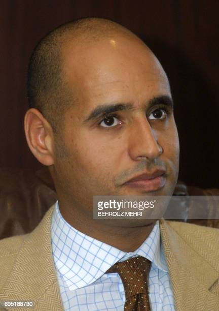 Pictured dated 02 Marh 2002 shows Seif ElIslam son of Libyan leader Moamer Kadhafi upon his arrival in Libya's northern coastal city of Syrte to...