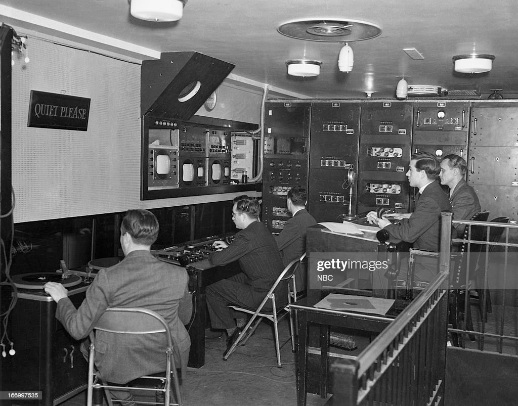Enigineers and techincians in the Studio 4H control room of NBC Studios Radio City located at Rockefeller Center in New York, NY in the late 1930s --
