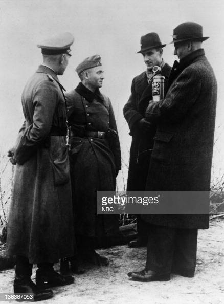 German soldiers of the Third Reich with NBC News' Foreign Correspondent Max Jordan broadasting a German Christmas celebration at the Siegfried Line...