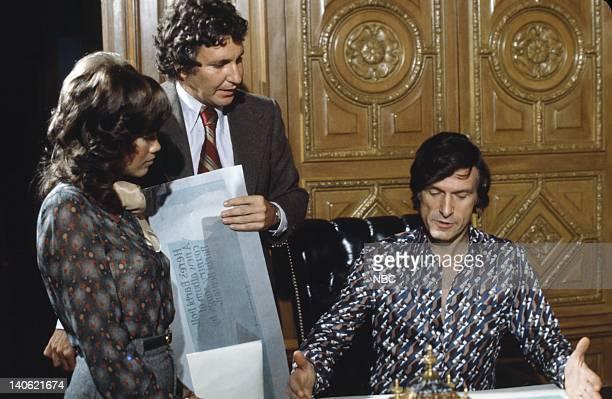 Hefner's girlfriend/Singer Barbi Benton unknown Playboy founder Hugh Hefner discussing promotional artwork for Barbi's 1974 debut album 'Barbi Doll'...