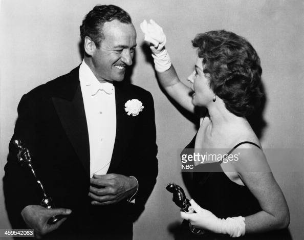 Host David Niven winner of Best Actor for 'Separate Tables' Susan Hayward winner of Best Actress for 'I Want to Live' during the 31st Annual Academy...