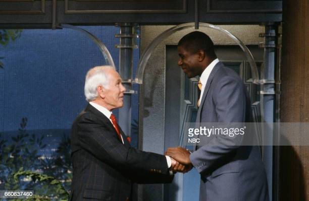 Host Johnny Carson greets professional basketball player Magic Johnson as he arrives on July 17 1991
