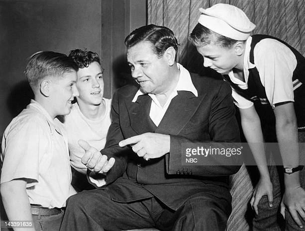 Host/baseball player Babe Ruth with young fans in 1944