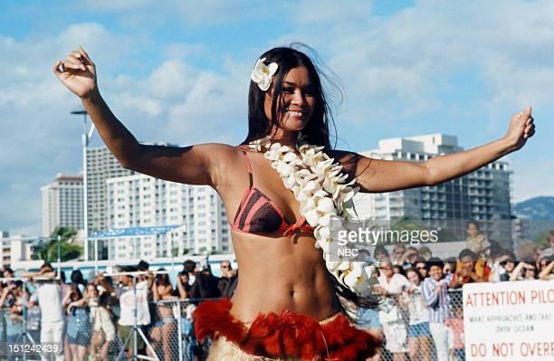 Hula dancer greets Elvis Presley when he arrives in Hawaii for his televised concert