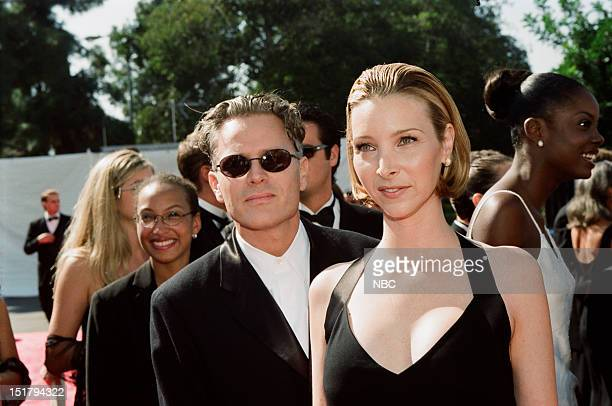 Husband Michel Stern Lisa Kudrow arrives at the 50th Annual Primetime Emmy Awards held at the Shrine Auditorium in Los Angeles CA on September 13 1998