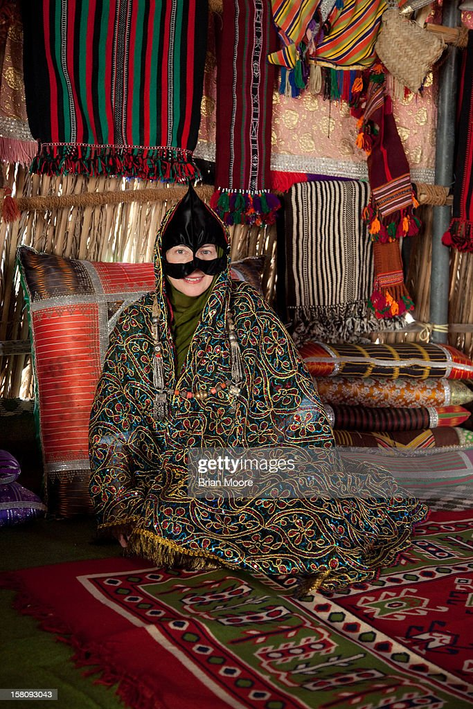 Pictured is a women in traditional Bedouin dress Near Mintirib, Oman