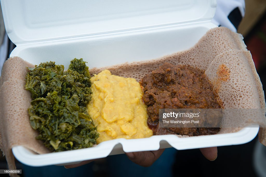Pictured is an order of Spicy Beef Stew (Key Siga Wot) with a side order of Yellow Split Pea Stew (Alecha Ater Kik) and Collard Greens (Yeabesha Gomen Wot). Co-ownersPina Fisseha and Nebeyou Lemma run a food truck called Mesob on Wheels. On this day they are parked in an industrial park in Beltsville, MD.