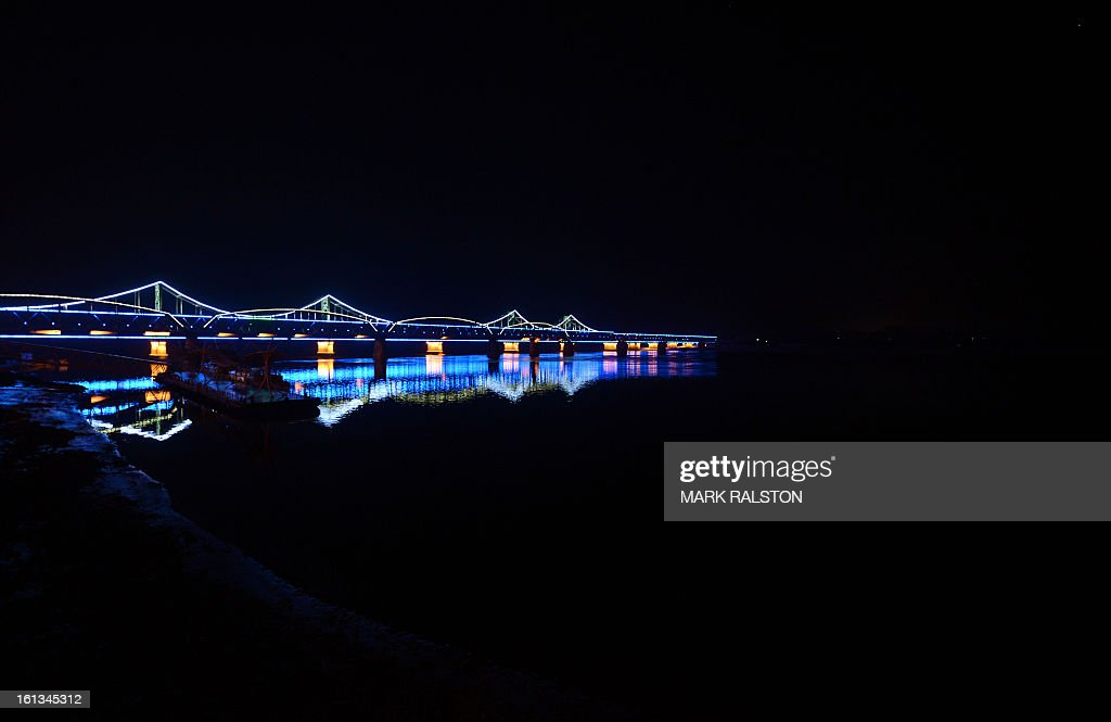 Pictured, is the Sino-Korean Friendship bridge taken from the Chinese town of Dandong and which ends in total darkness at the North Korean town of Sinuiju, on February 10, 2013. US Secretary of State John Kerry warned that North Korea's expected nuclear tests only increase the risk of conflict and would do nothing to help the country's stricken people. The country has vowed to carry out a third nuclear test soon, and concerns have been raised over the type of fissile material used in the device. AFP PHOTO/Mark RALSTON