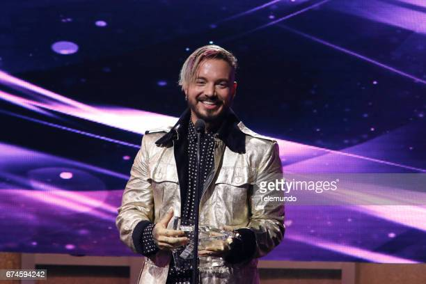 J Balvin accepts the Album 'Latin Rhythm' del Ano and 'Latin Rhythm Albums' Artista del Ano Solista awards on stage at the Watsco Center in the...