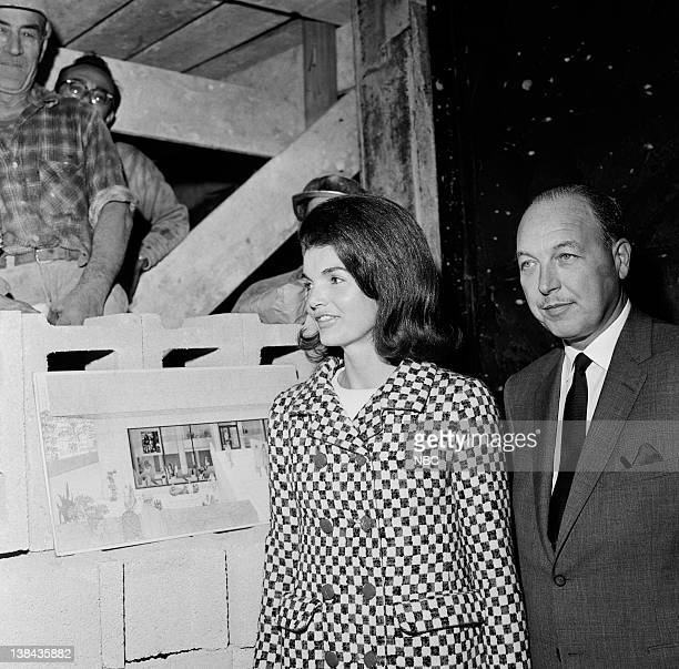 Jacqueline Kennedy and NBC President Robert at the construction site of the Whitney Museum in New York City on October 21 1965