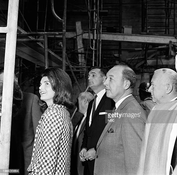 Jacqueline Kennedy NBC President Robert Sarnoff and architect Marcel Breuer touring the construction site of the Whitney Museum in New York City on...