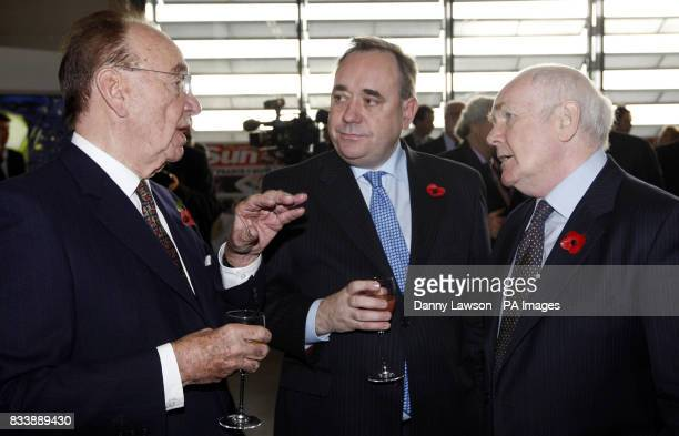 Pictured left to right News International media tycoon Rupert Murdoch Scotland's First Minister Alex Salmond and John Reid during the opening of the...