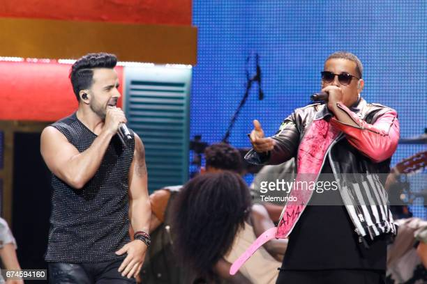 Luis Fonsi Daddy Yankee perform on stage at the Watsco Center in the University of Miami Coral Gables Florida on April 27 2017