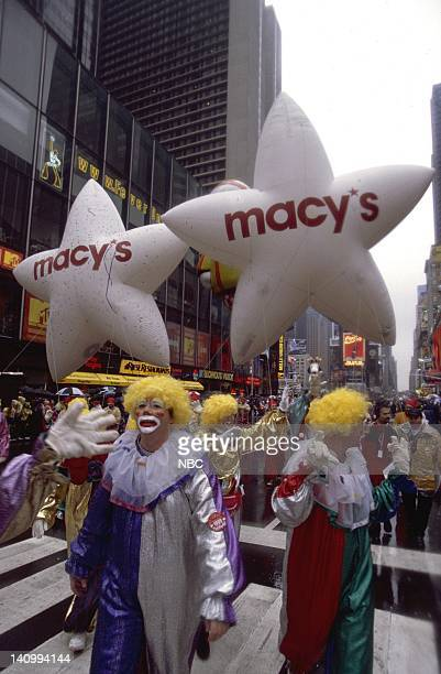 Macy's volunteer clowns walk with the Macy's star balloons during the 1999 Macy's Thanksgiving Day Parade Photo by Craig Blankenhorn/NBCU Photo Bank