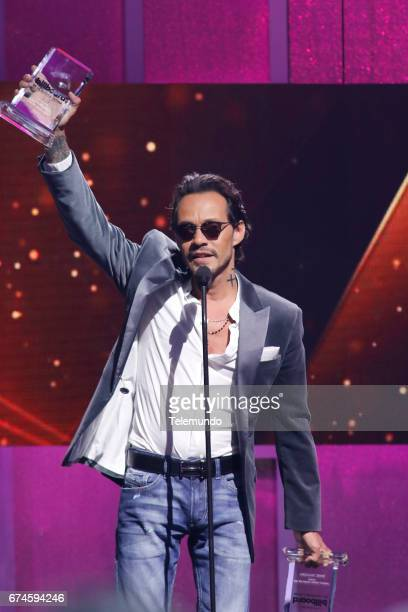 Marc Anthony accepts the Tropical Albums Artista del Ano Solista award on stage at the Watsco Center in the University of Miami Coral Gables Florida...