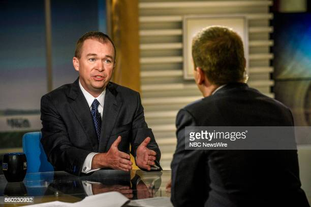 Mick Mulvaney Director of the Office of Management Budget and moderator Chuck Todd appear on 'Meet the Press' in Washington DC Sunday Oct 8 2017