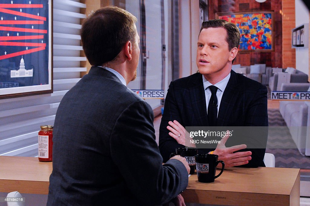 Moderator Chuck Todd, left, and Willie Geist, 'Today Show' co-host, right, appear on 'Meet the Press' in Washington, D.C., Sunday, Oct. 19, 2014.