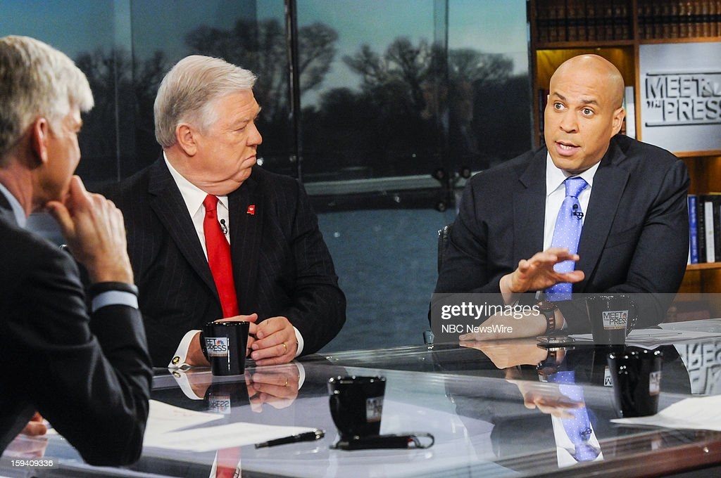 – Moderator David Gregory, left, Fmr. Gov. Haley Barbour (R-MS) center, and Mayor Cory Booker (D-Newark) right, appear on 'Meet the Press' in Washington D.C., Sunday, Jan. 13, 2013.