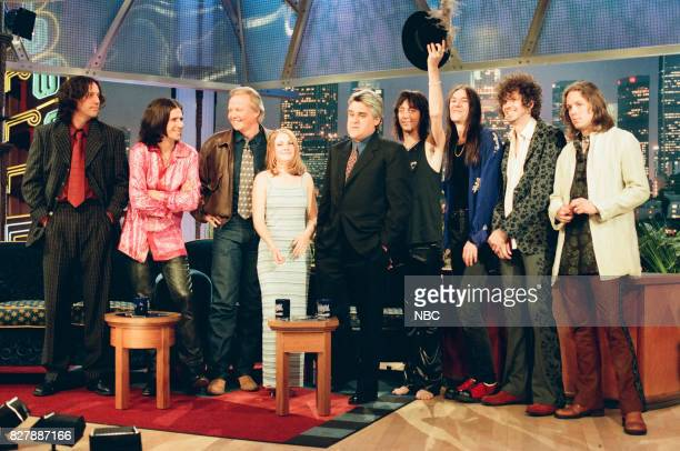 Musical group the Black Crowes actor Jon Voight actress Melissa Joan Hart and host Jay Leno pose for a photo on April 28 1999