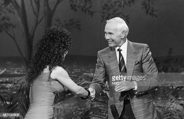 Musical guest Gloria Estefan greets host Johnny Carson on July 18 1991