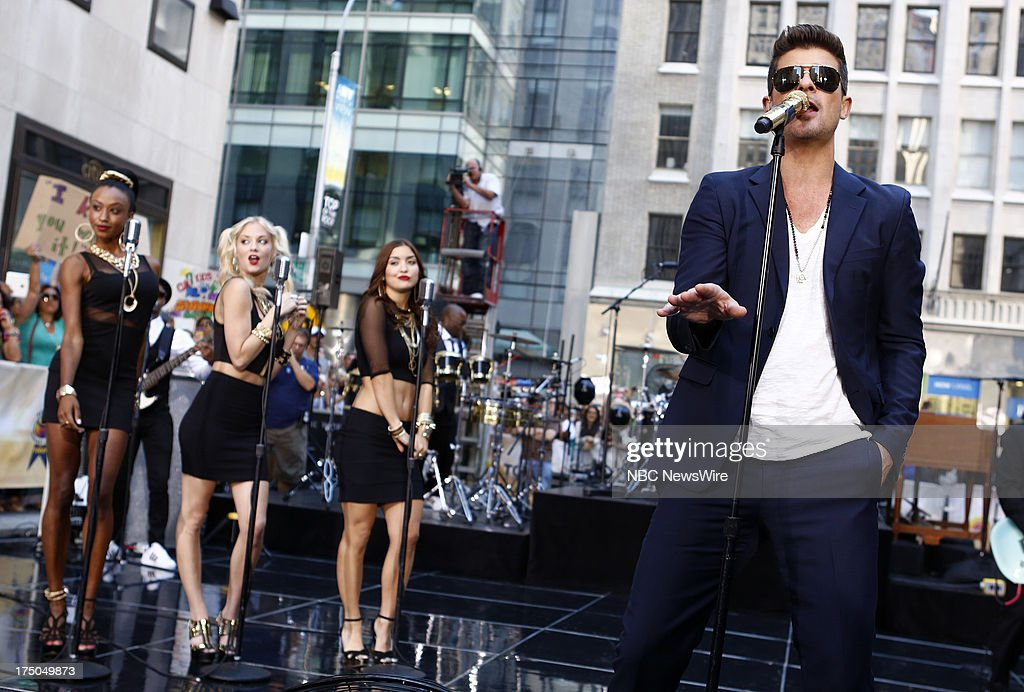 Musicial guest <a gi-track='captionPersonalityLinkClicked' href=/galleries/search?phrase=Robin+Thicke&family=editorial&specificpeople=724390 ng-click='$event.stopPropagation()'>Robin Thicke</a> appears on NBC News' 'Today' show on July 30, 2013 --