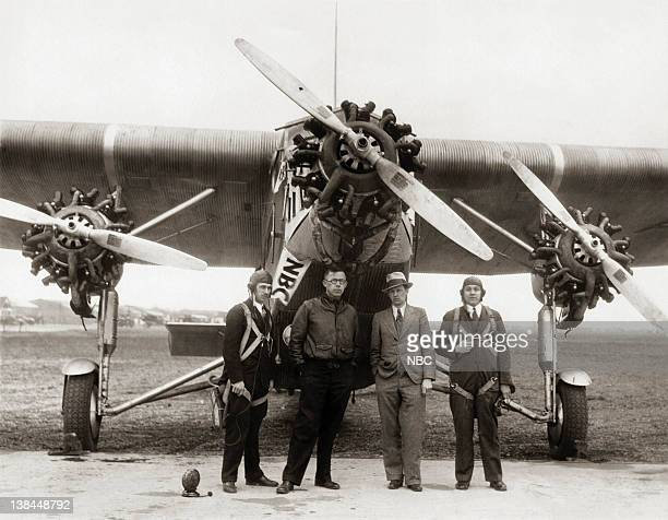 NBC announcers engineers and United States army men prepare for a broadcast from a trimotored monoplane for a birds eye description of the Army Air...
