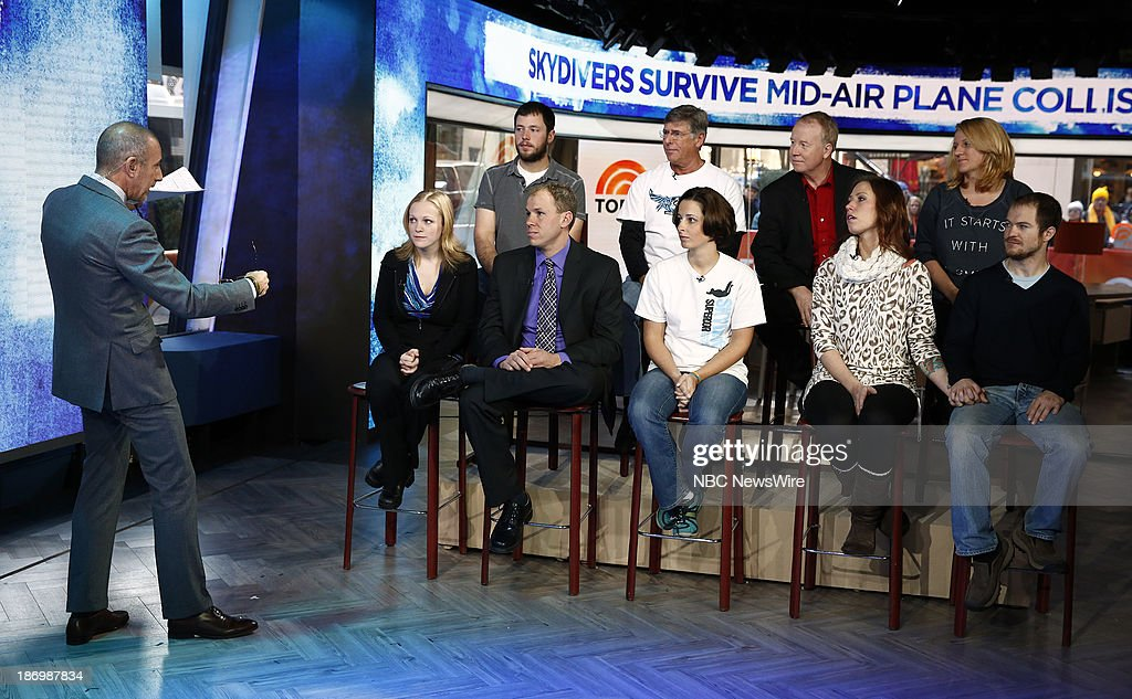 NBC News' Matt Lauer, survivors of the skydiving planes that collided midair Amy Olson, Chad Ebling, Daniel Chandler, Barry Sinnex, Sarah Perrine, Mike Robinson, Patricia Roy, Lanaya Bonogofsky and John Rodrigo appear on NBC News' 'Today' show on November 5, 2013 --