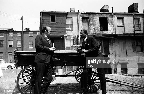 NBC News' Sander Vanocur Floyd McKissick leader of CORE the Congress of Racial Equality in a black ghetto in Baltimore Maryland during an NBC News...