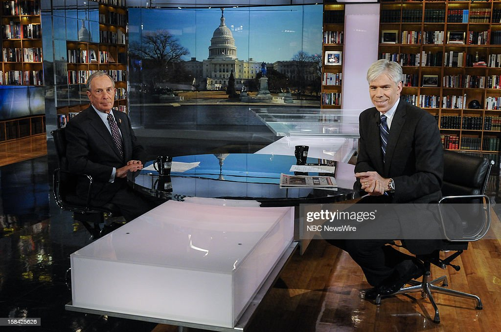 – New York City Mayor Michael Bloomberg, left, and moderator David Gregory, right, appear in a pre taped interview on 'Meet the Press' in Washington D.C., Saturday, Dec. 15, 2012.