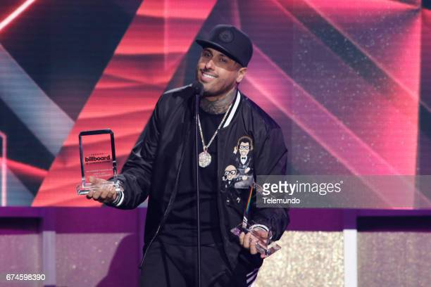 Nicky Jam accepts the award for 'Hot Latin Songs' Artista Del Ano Solista on stage at the Watsco Center in the University of Miami Coral Gables...