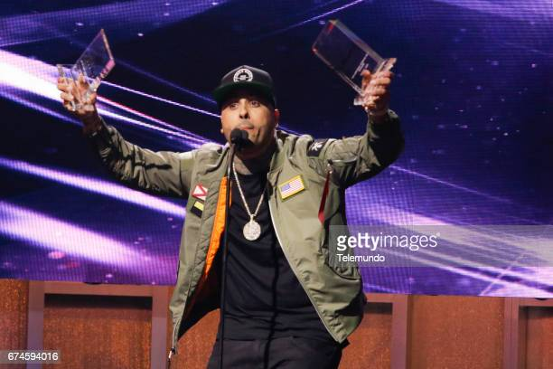 Nicky Jam accepts the 'Hot Latin Songs' award on stage at the Watsco Center in the University of Miami Coral Gables Florida on April 27 2017