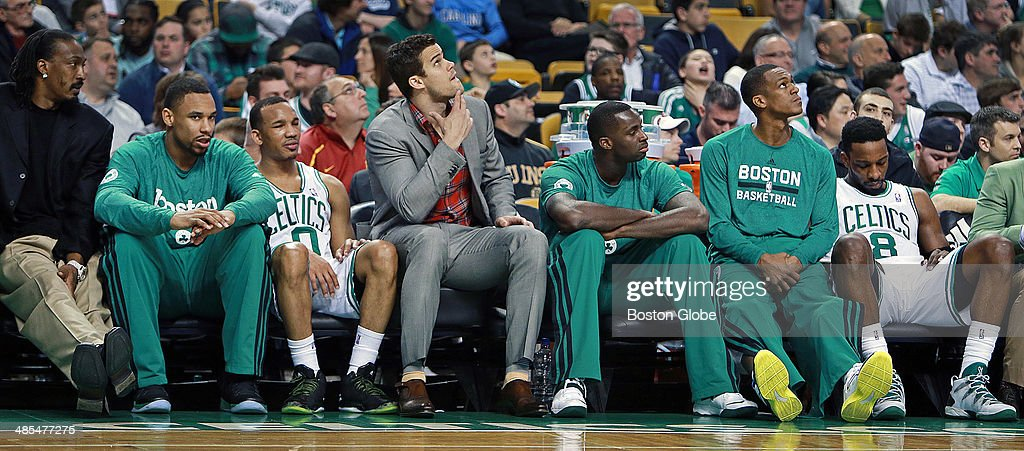 Pictured on the Celtics bench as the final minutes of the season tick off the clock are, left to right, Gerald Wallace, Jared Sullinger, Avery Bradley, Kris Humphries, Brandon Bass, Rajon Rondo and Jeff Green. The Boston Celtics hosted the Washington Wizards in their final NBA game of the season at the TD Garden on Wednesday, April 16, 2014.